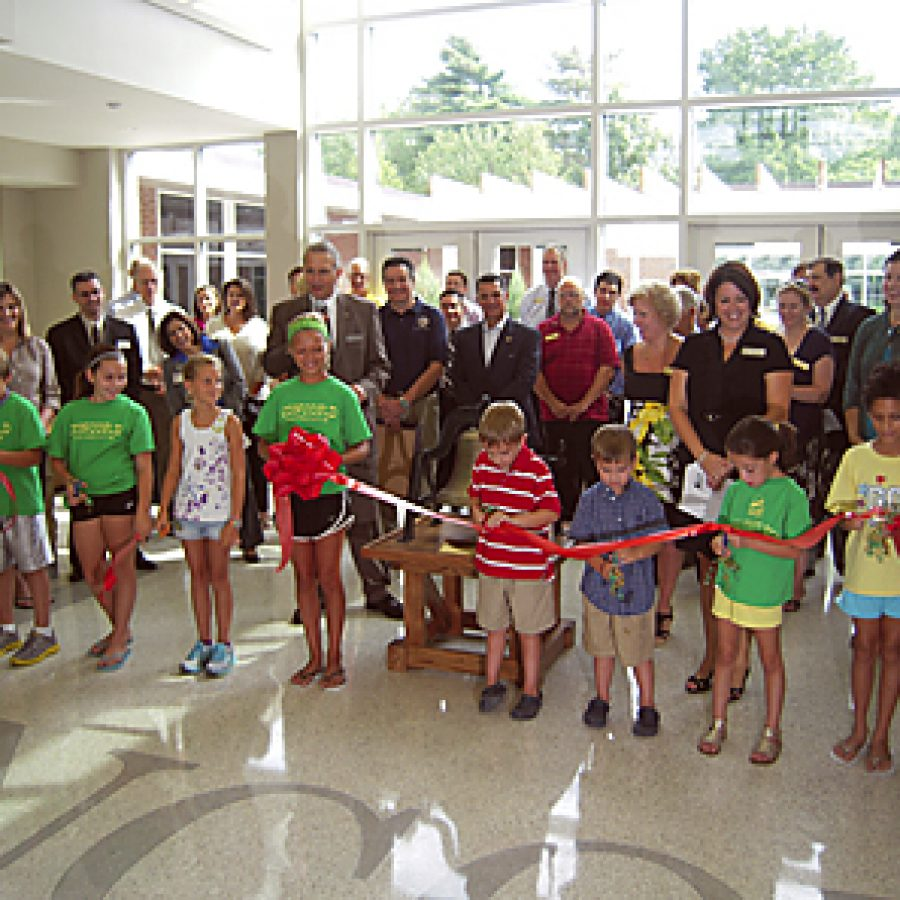 Lindbergh Schools celebrates the grand reopening of Concord Elementary School with a ribbon-cutting ceremony that included ringing a bell discovered during building renovation and restored to its original beauty. The ceremony marked the first time in 50 years the district has opened a new elementary school. Mike Anthony photo