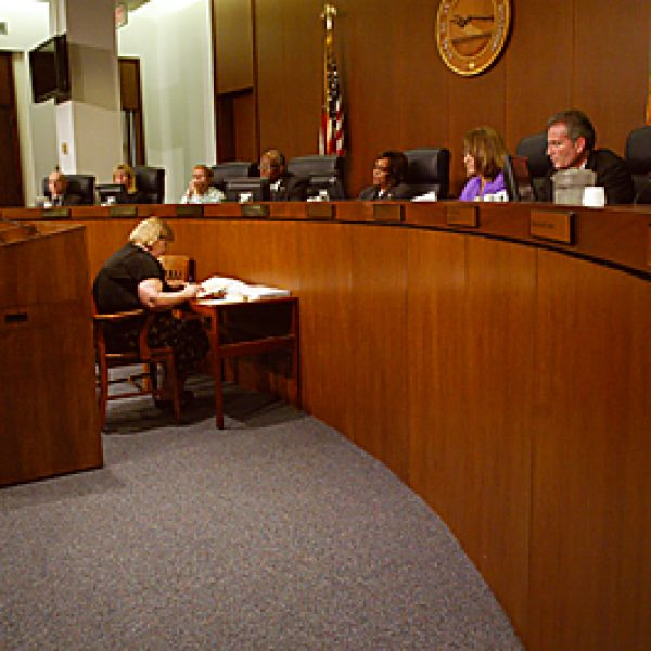 Maryland Heights City Clerk Jan Telthorst, left, addresses the County Council last week about the negative impact a proposed ban on public smoking would have on her community. A countywide public smoking ban referendum may be considered by voters in November. Bill Milligan photo