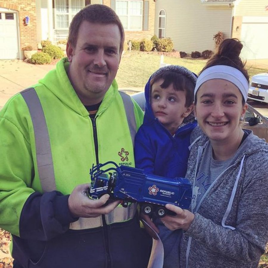 Fred Davenport, left, gave a mini trash truck to Sam Miskovic, left, for Christmas. Also pictured is Sam's mother Annie Miskovic.