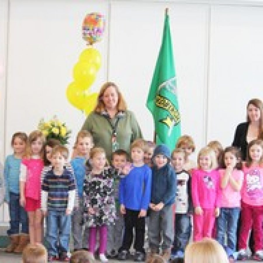 Lindbergh Early Childhood Education teacher Lisa Janis is honored as the National Child Care Teacher of the Year by her prekindergarten students in the Lions class during a surprise announcement last week.