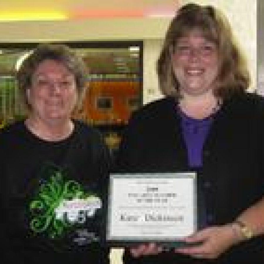 Oakville Elementary School music teacher Karen Dickinson, recipient of the Missouri South Arts Council's 2008-2009 Fine Arts Teacher of the Year Award, is shown with Judy Rethwisch, left, MSAC artistic director.