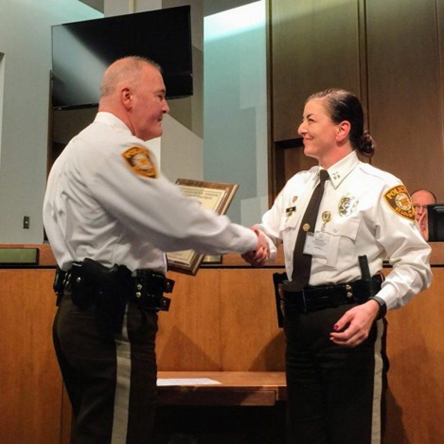 Chief Jon Belmar congratulates Capt. Melissa Webb on her promotion to captain Wednesday.