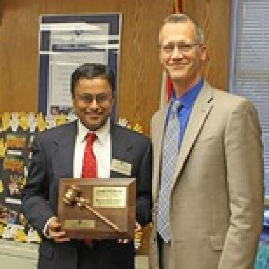 Venki Palamand, who served six years on the Mehlville Board of Education, was honored for his service last week. Palamand, left, who served as board president the past two years, is shown with Superintendent Eric Knost.