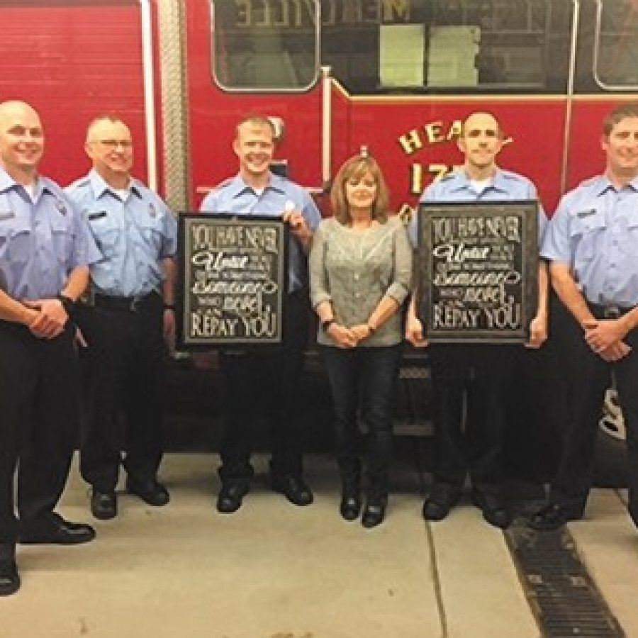 Oakville resident Toni Hodge attended last week's Mehlville Fire Protection Dis-trict Board of Directors meeting to thank the firefighter/medics who saved her life in October when they responded to a 911 call she made. She presented them with plaques stating she could never repay them for what they did. Pictured, from left, are: Pvt. Darren Plogger, Pvt. Don Wood, Pvt. Jason Schenimann, Hodge, Pvt. Patrick O'Brien and Pvt. Nick Klemme.
