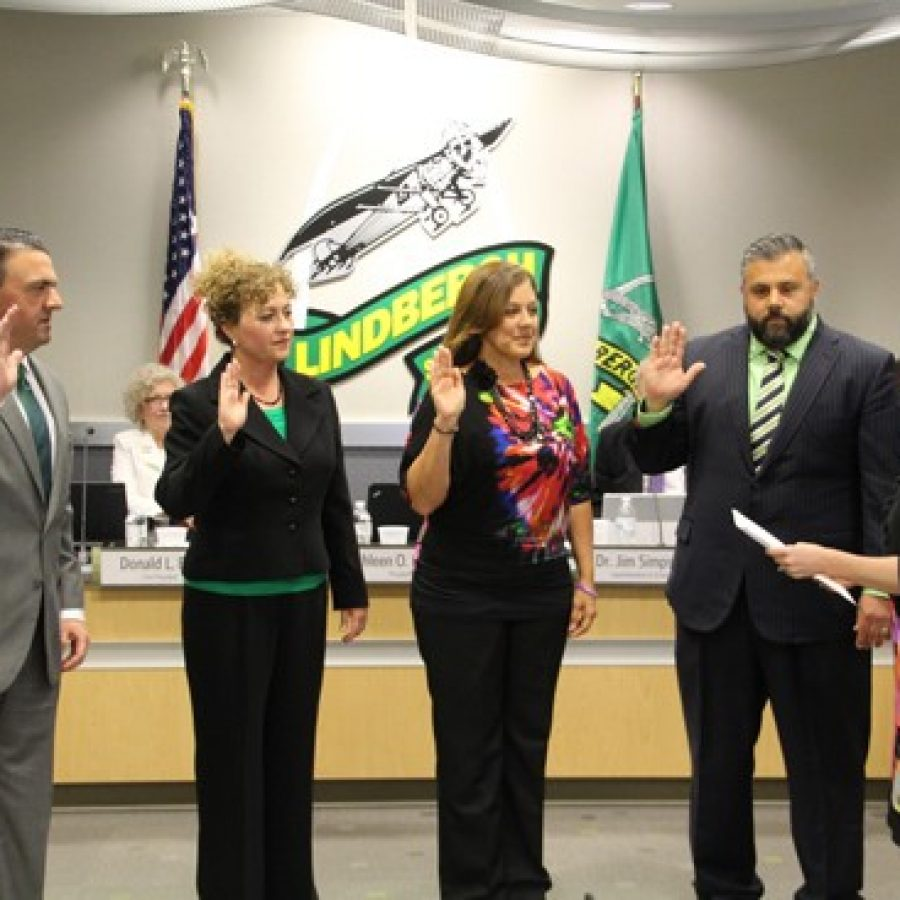 The LAWS slate of new Lindbergh board members are sworn in Tuesday by board Secretary Karen Schuster. Pictured from left are: Mike Shamia, Christy Watz, Cathy Carlock Lorenz and Matt Alonzo.
