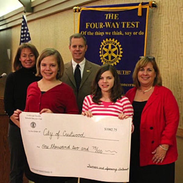 Truman Middle School sixth-grader Emma Deutschmann, left, and Sperreng Middle School seventh-grader Katie Spradling present a donation to Crestwood Mayor Jeff Schlink at the Dec. 22 Crestwood Sunset Hills Rotary Club meeting. They are joined by club sponsors Jane Hake, right, and Debbie Schiavo, left.
