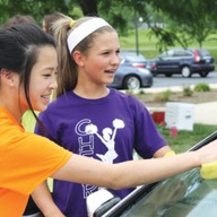Seventh-graders participating in the car wash included Alena Hong, left, and Libby Uttendorf.