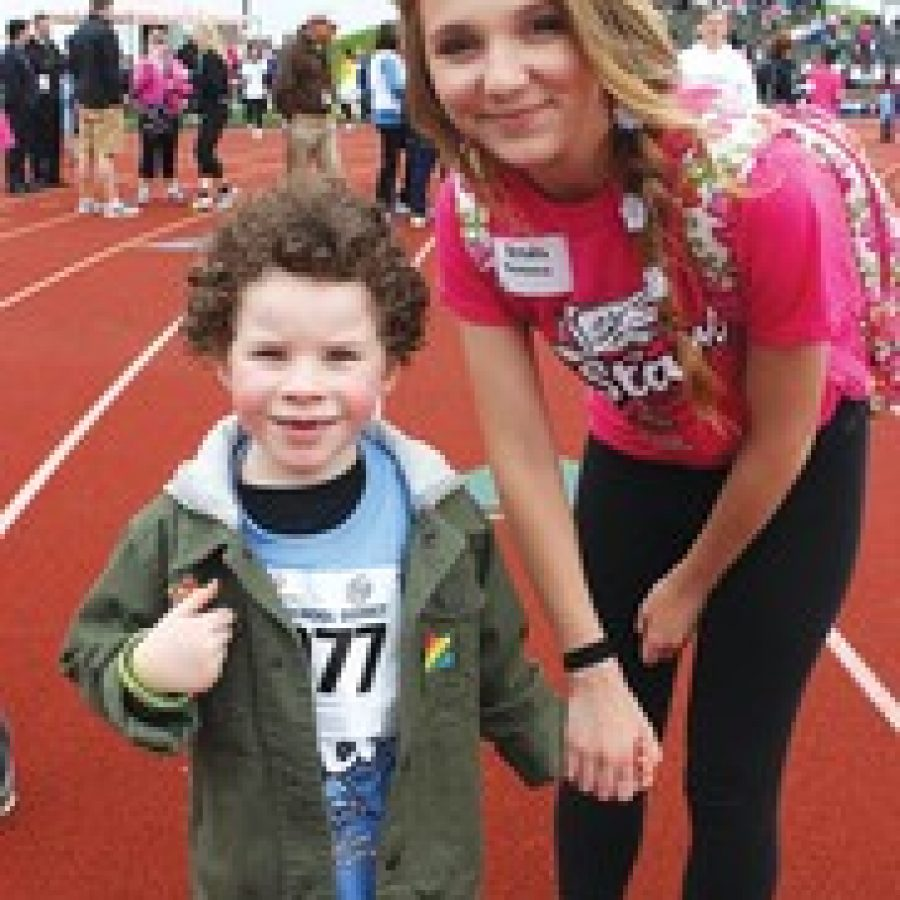 Trautwein kindergarten student Tyler Hornberger is pictured with Mehlville High student Kendra Ryan at the recent Special Olympics event on the Mehlville High campus.