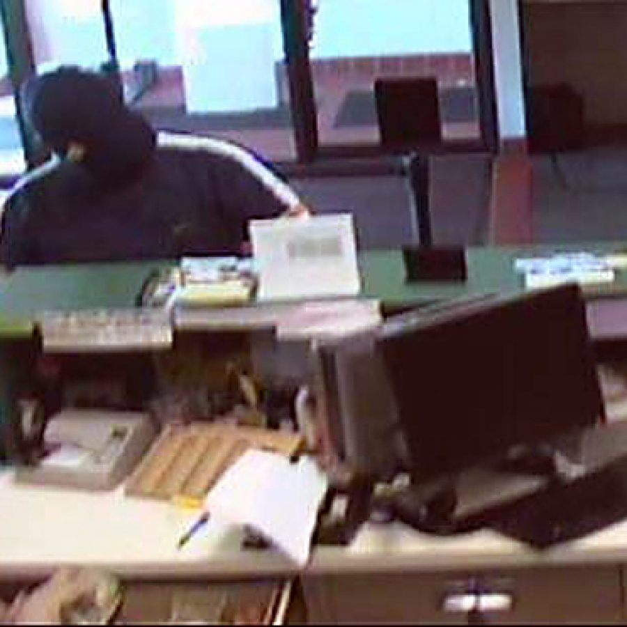 Surveillance cameras capture photos of the man who robbed the Electro Savings Credit Union on Tesson Ferry Road on Friday morning.