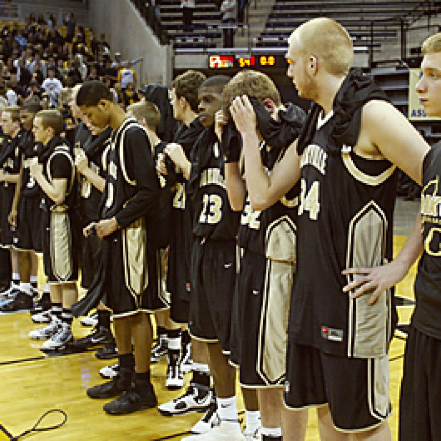 Coaches and members of the 2009-10 Oakville Tiger varsity basketball team seem devastated after an 11-point swing during the final three minutes of play left them clutching a second-place trophy instead of the State championship at Mizzou arena Sunday. Bill Milligan photo