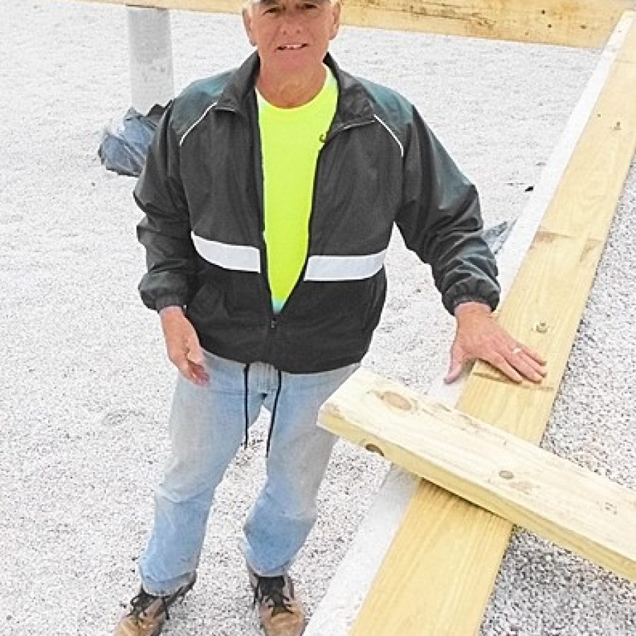 Charlie Keller of the Queen of All Saints St. Louis Sluggers inspects the foundation of a Habitat for Humanity home before his crew starts to construct the flooring system.