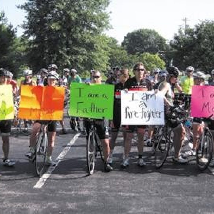Bicyclists rally at Sunset Hills City Hall Saturday following an alleged hit-and-run between a bicyclist and the mayor.