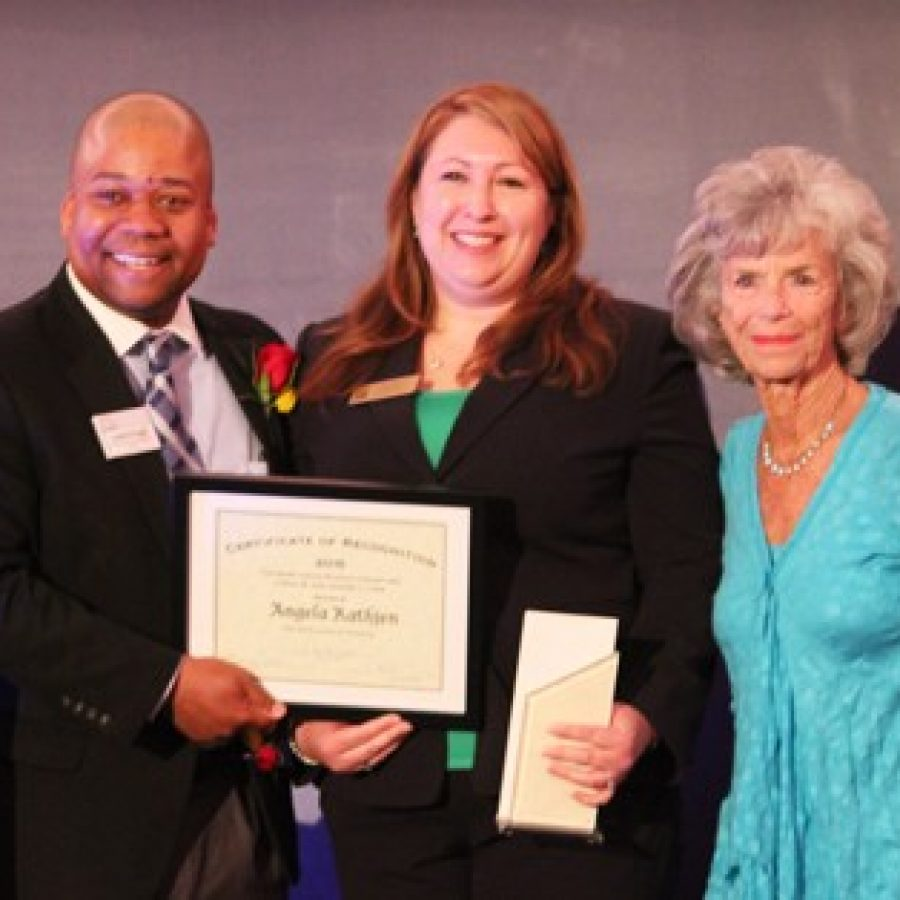 Sperreng Middle School science teacher Angela Rathjen, center, receives the 2015 Loeb Prize for Excellence in Teaching Science and Mathematics. She is pictured with Christian Greer, chief education and programs officer for the St. Louis Science Center, and Carol Loeb, a member of the Science Center Board of Trustees.