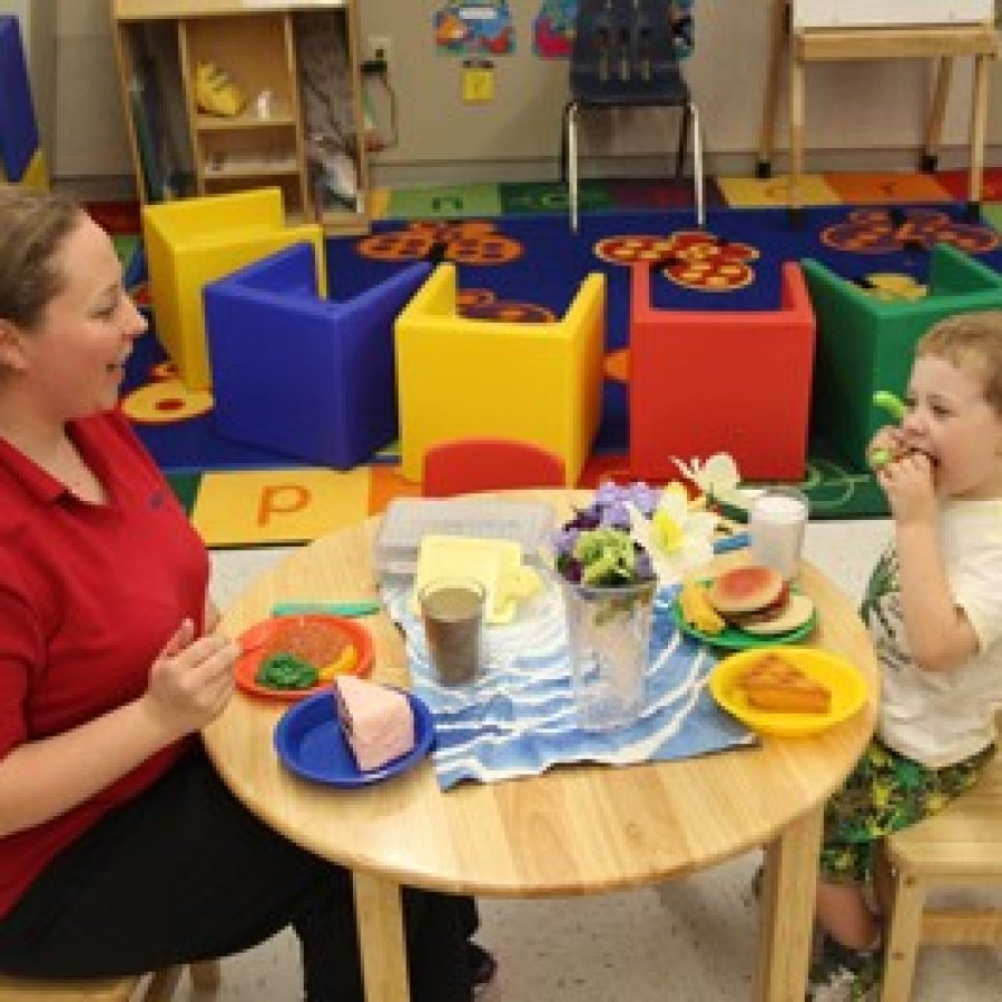 A student and his mom have fun playing in the Dolphin Room at Lindbergh Early Childhood Education during the new building's open house on Tuesday.
