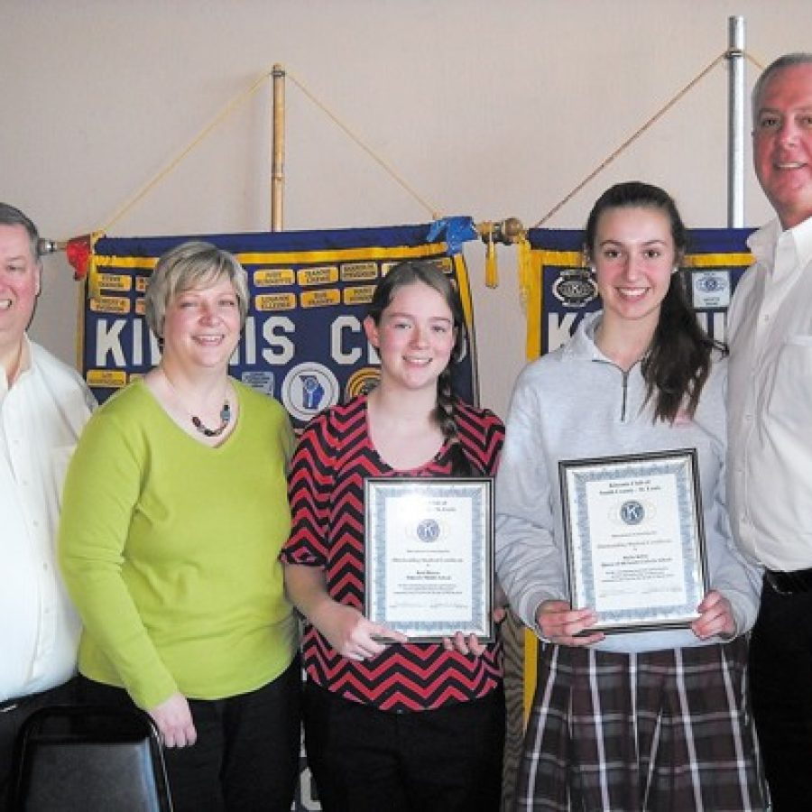 Kiwanis Students of the Month Keri Hinsen and Hallie Kilfoy are pictured with their parents, Mark and Tara Hinsen and Tim Kilfoy.