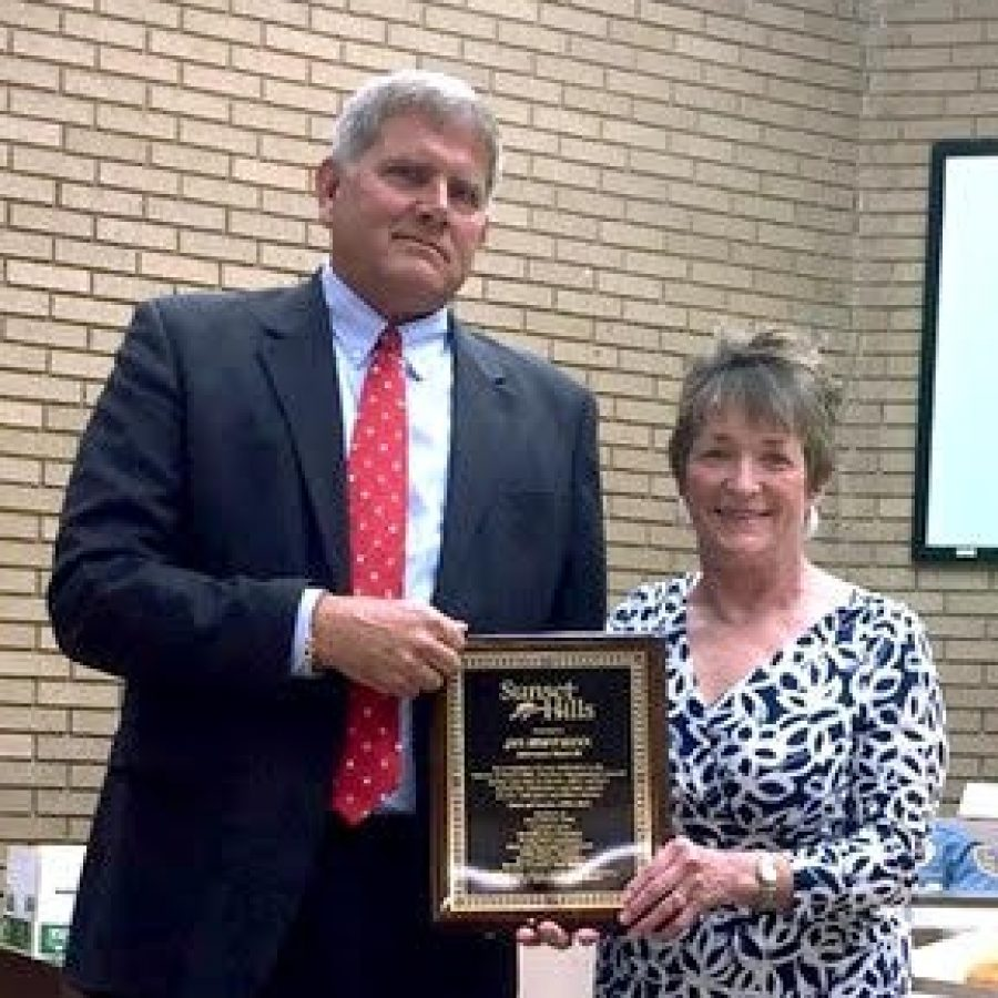 Mayor Mark Furrer, left, giving a plaque of recognition to former Ward 3 Alderman Jan Hoffmann when she stepped down from the board April 28.