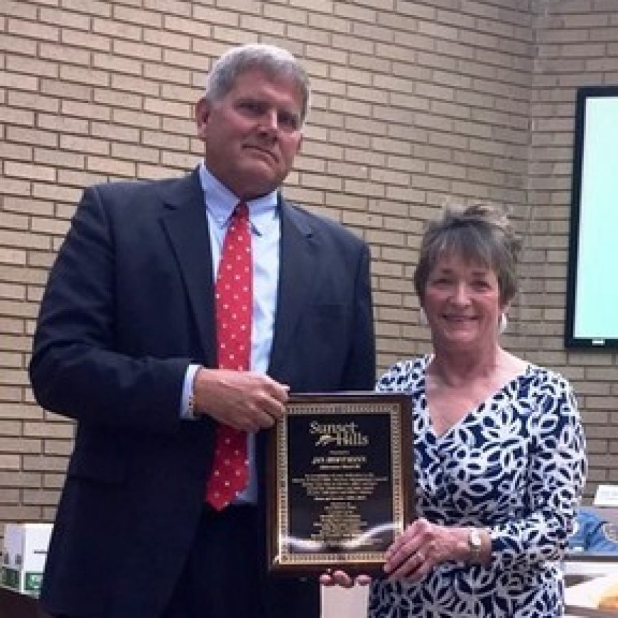 Mayor Mark Furrer, left, with former Ward 3 Alderman Jan Hoffmann the night she left the board.
