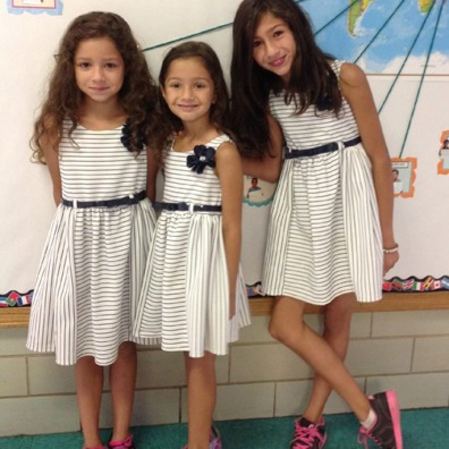 Sisters  from left, Isabella, Sabrina and Sandra Halilovic donned matching dresses Sept. 30 for picture day at Crestwood Elementary School. Lindbergh's districtwide picture day is also 'Be There Day,' or the official enrollment date for the 2015-2016 school year. This year the district saw an increase of 200 new students in grades K-12. The sisters are in grades three, kindergarten and four, respectively.