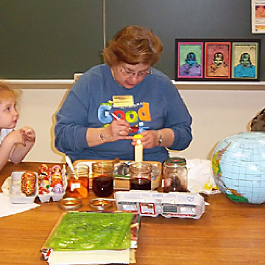 Beasley Elementary librarian Madelynn Kennebeck teaches students the techniques for painting Ukranian eggs during the school's Fine Arts Day held on April 21.
