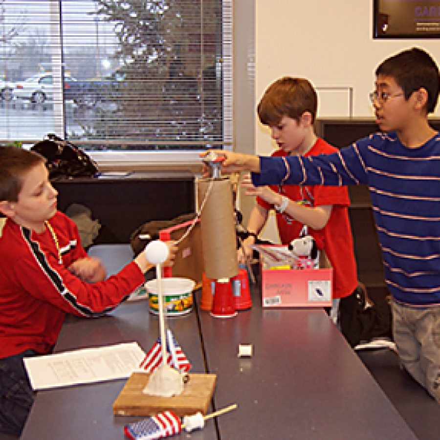 Margaret Buerkle Middle sixth-graders, from left, Jacob Henzler, Jared Jacquot and Jack Chen construct their machine during the District's STRETCH gifted program's Rube Goldberg Competition.
