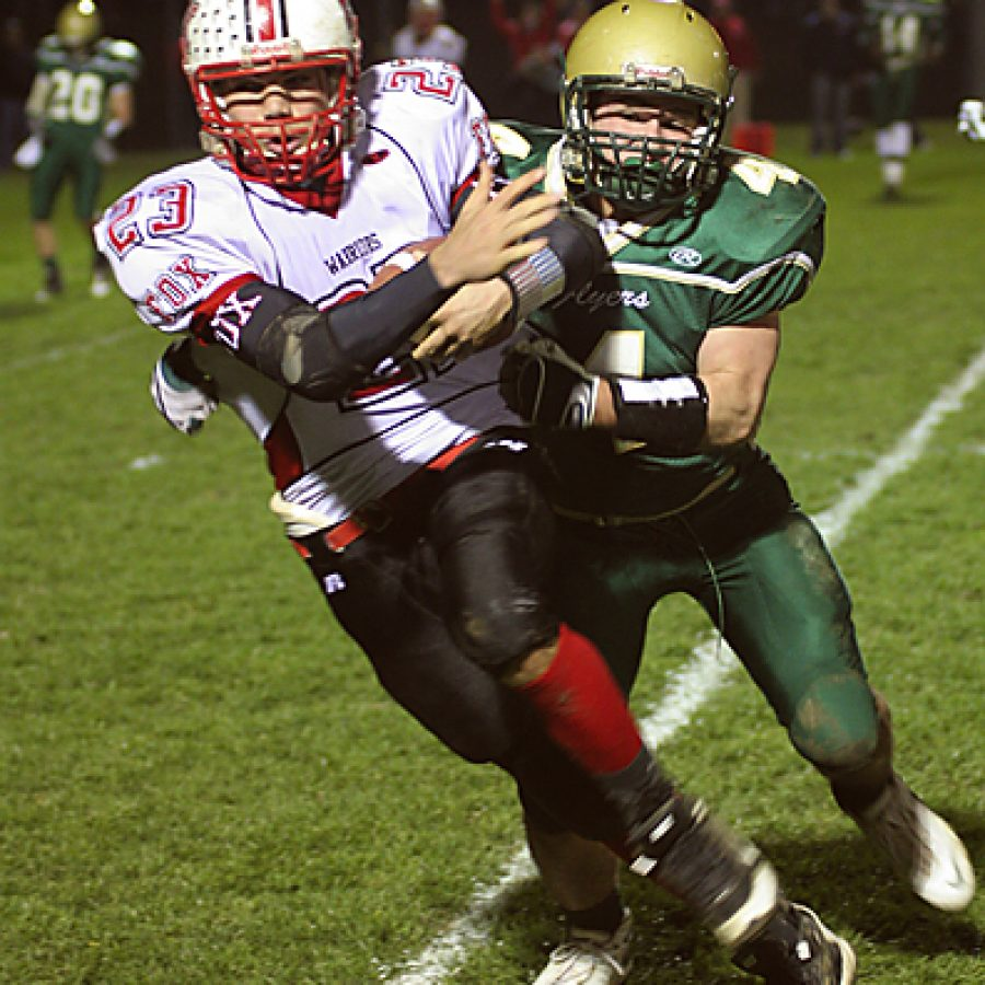 Fox running back Jimmy Brewer cuts to the outside with Lindbergh linebacker Eric Schwartz in pursuit during the Warriors' 31-28 win Friday night. Stephen Glover photo