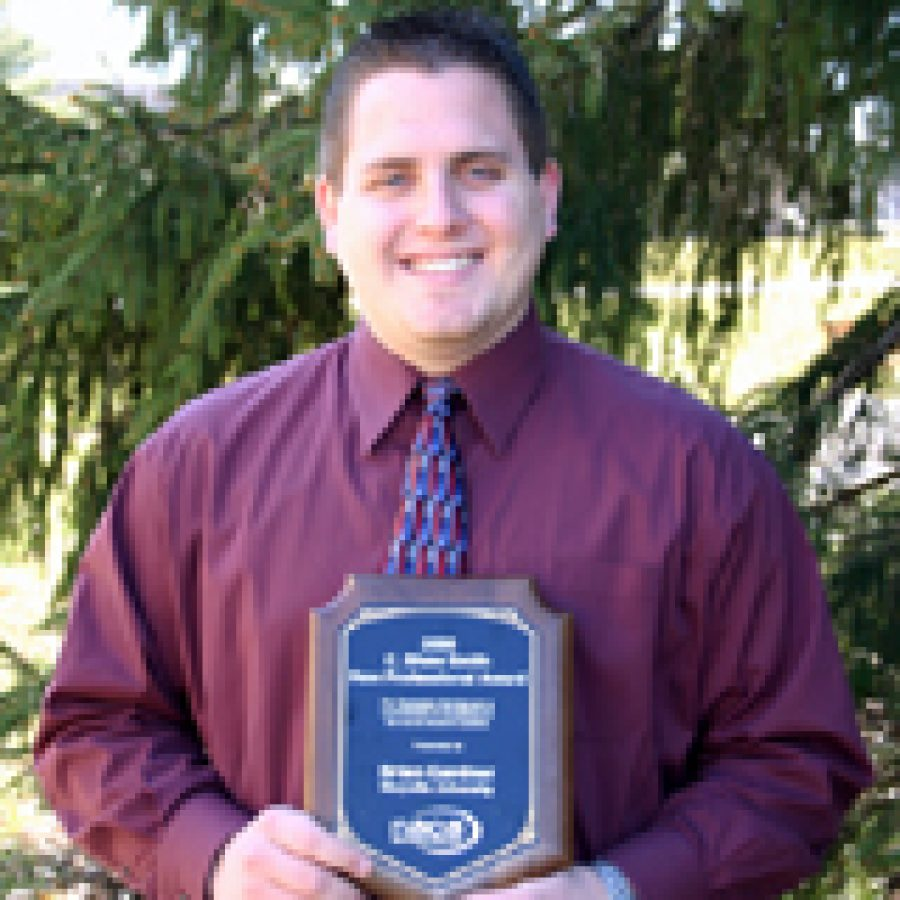 Oakville graduate Brian Gardner displays his C. Shaw Smith New Profes-sional Award for his work on campus activities at Maryville University.