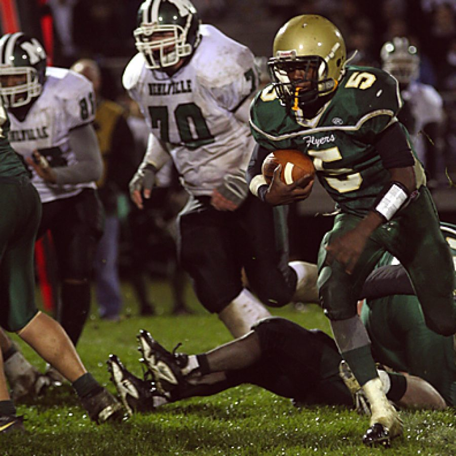 Lindbergh High Schools Tim Hamm-Bey cuts to the outside in the Flyers 32-6 win over Mehlville Friday night at home in the first round of the Missouri Class 6, District 2 football playoffs. Stephen Glover photo