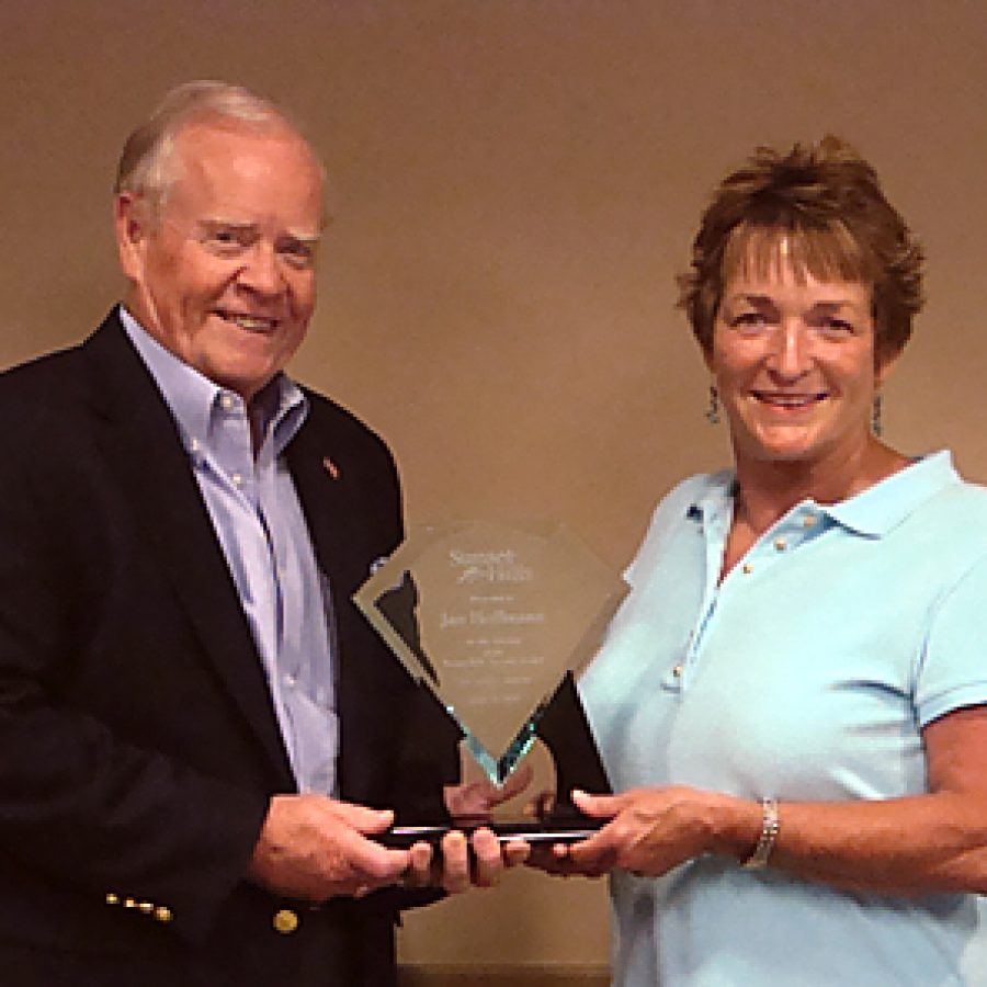 Sunset Hills Mayor Bill Nolan and Ward 3 Alderman Jan Hoffmann are shown with the award presented to Hoffmann for her efforts leading to the construction of the city's first swimming pool and the construction of the city's new Aquatic Center that replaces the original pool.