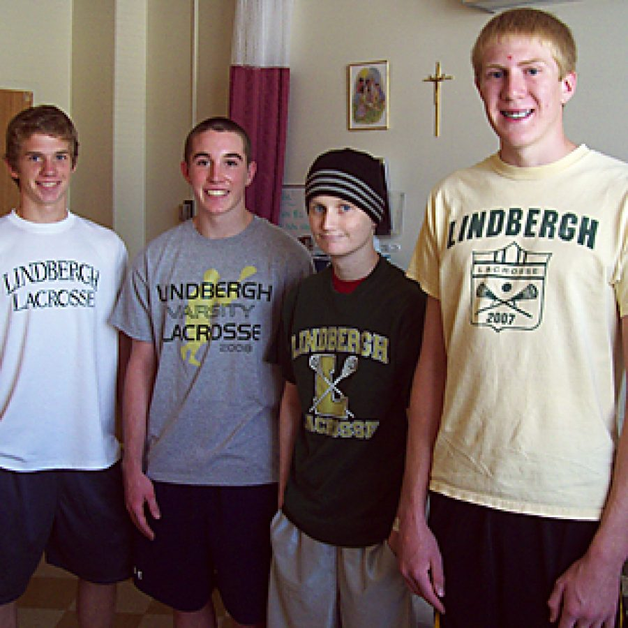 Lindbergh Lacrosse players Andy Thurby, D.J. Ullrich, Jake Franzel and Steve Kaiser catch up in Jake's room at Cardinal Glennon. Jake's teammates raised \$1,250 in his honor last spring, which has been donated to Friends of Kids With Cancer and the Make-a-Wish Foundation.