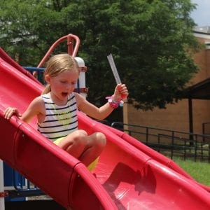An incoming Kennerly kindergartener slides at 'Popsicles with the Principal' in 2018 on the school's playground.  Photo by Jessica Belle Kramer.