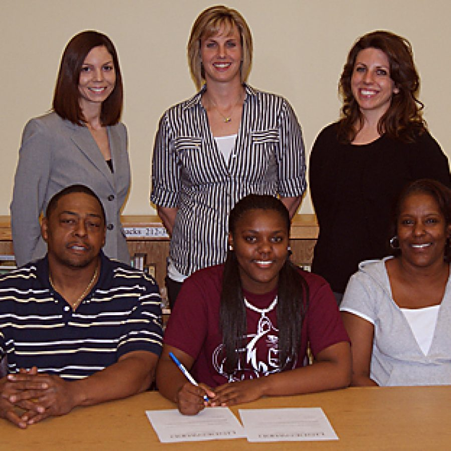 Mehlville High School senior Chanese Washington signed a letter of intent to continue her basketball career at the collegiate level when she joins the Lindenwood University – Belleville women's basketball team this fall. Pictured front row, from left, are: Carlton, Chanese and Stephanie Washington. Back row, from left, are: Annie Ewing, head coach of the Lindenwood University - Belleville women's basketball team; Laura Bishop, MHS varsity basketball coach and Jacqueline Wamser, MHS varsity basketball assistant coach.