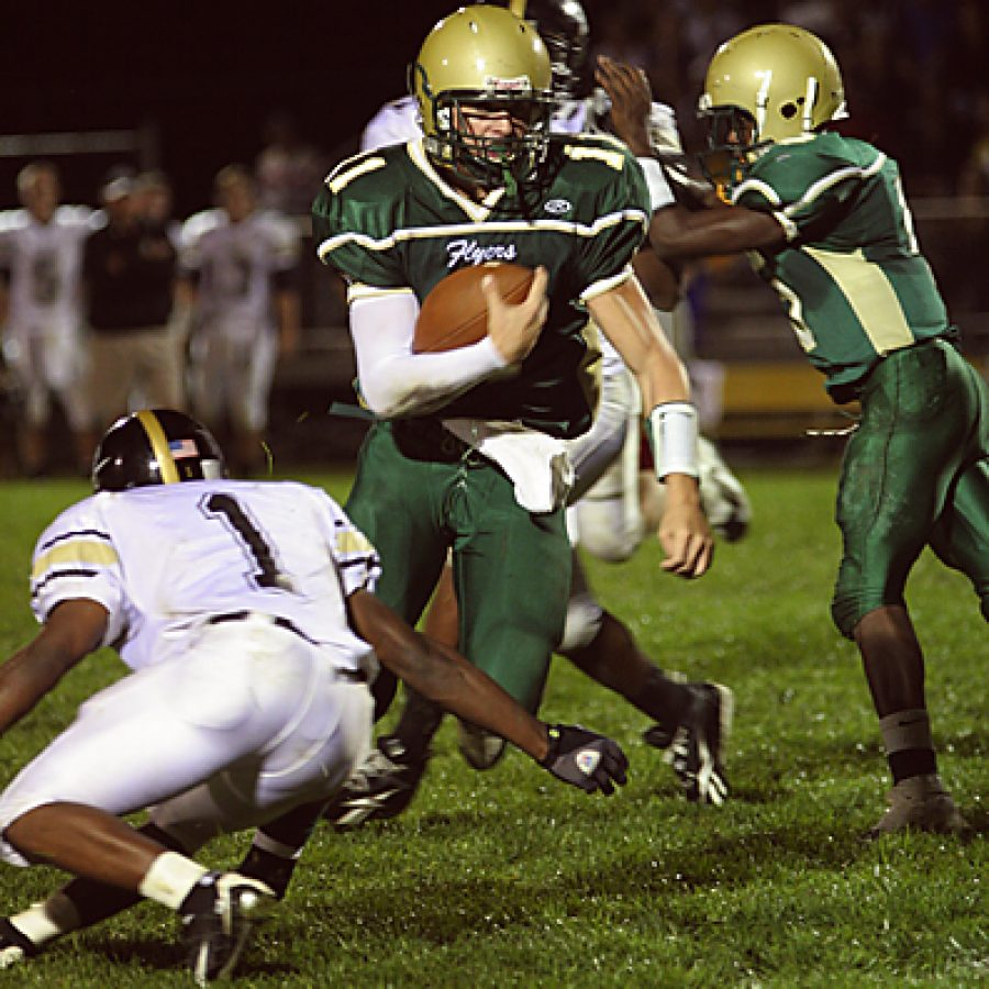 Lindbergh High School quarterback Kyle Portell breaks to the outside in the Flyers 38-14 win over Lafayette. Stephen Glover photo
