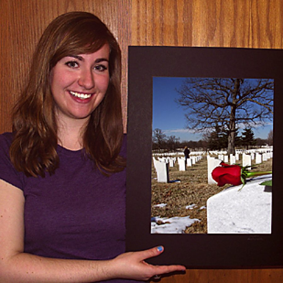 OHS junior Lauren Kuechenmeister poses with her photo, titled \