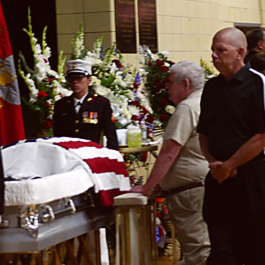 John Diethelm and Bob Keeling pay their respects to Cpl. Donald Marler during a visitation Monday afternoon at Oakville Senior High School. Cpl. Marler, a 2006 Oakville graduate, was one of three Marines killed in a single-vehicle crash June 6 during combat operations in Afghanistan. Bill Milligan photo