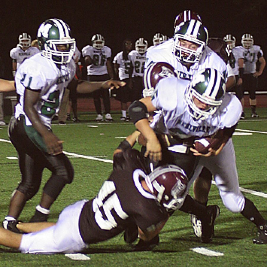 Stephen Glover photoMehlville junior running back Troy Parrot is hauled down by De Smet linebacker Reid Spalding in the Panthers' 38-0 loss Friday night. Stephen Glover photo