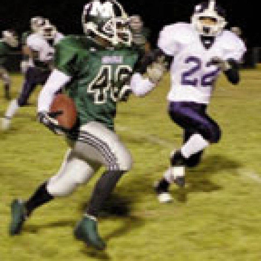Mehlville's Rickey Giles, left, runs for a touchdown in Friday's game against the Marquette Mustangs. Giles ran for 58 yards and caught two touchdown passes.Bill Milligan photo