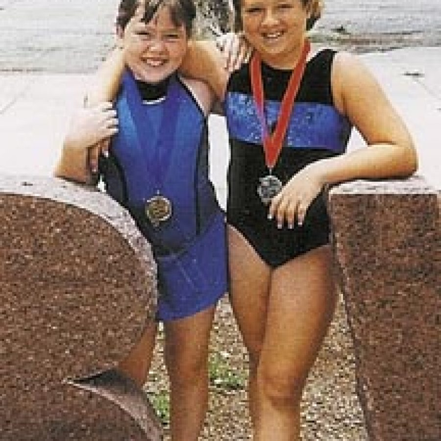 Becky Watters, left, and Jessica Frederick display their Prairie State Games medals.