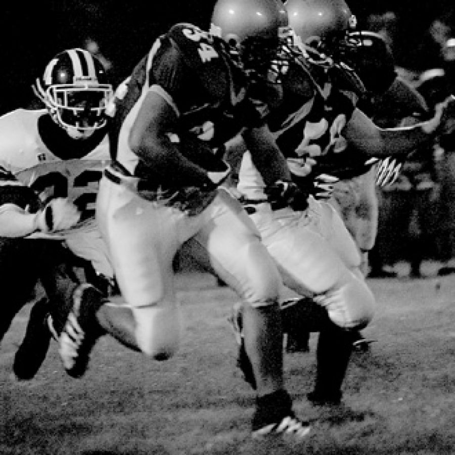 Bill Milligan photoLindbergh senior Charlie Schinsky plows through an opening in the Mehlville defense during the first quarter of Friday's 21-14 win over rival Mehlville.