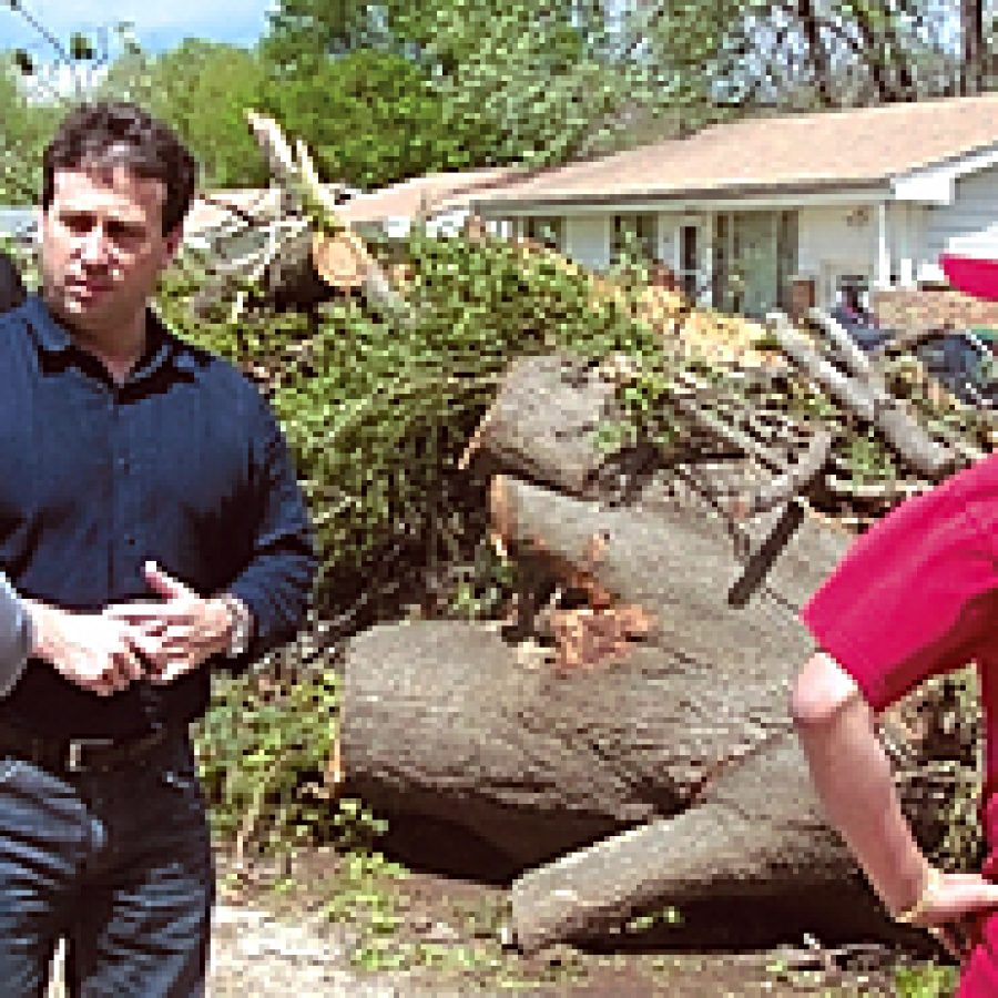 County Council Chairman Steve Stenger, third from left, speaks with Berkeley residents struggling to pick up the pieces after the devastating April 22 tornado.