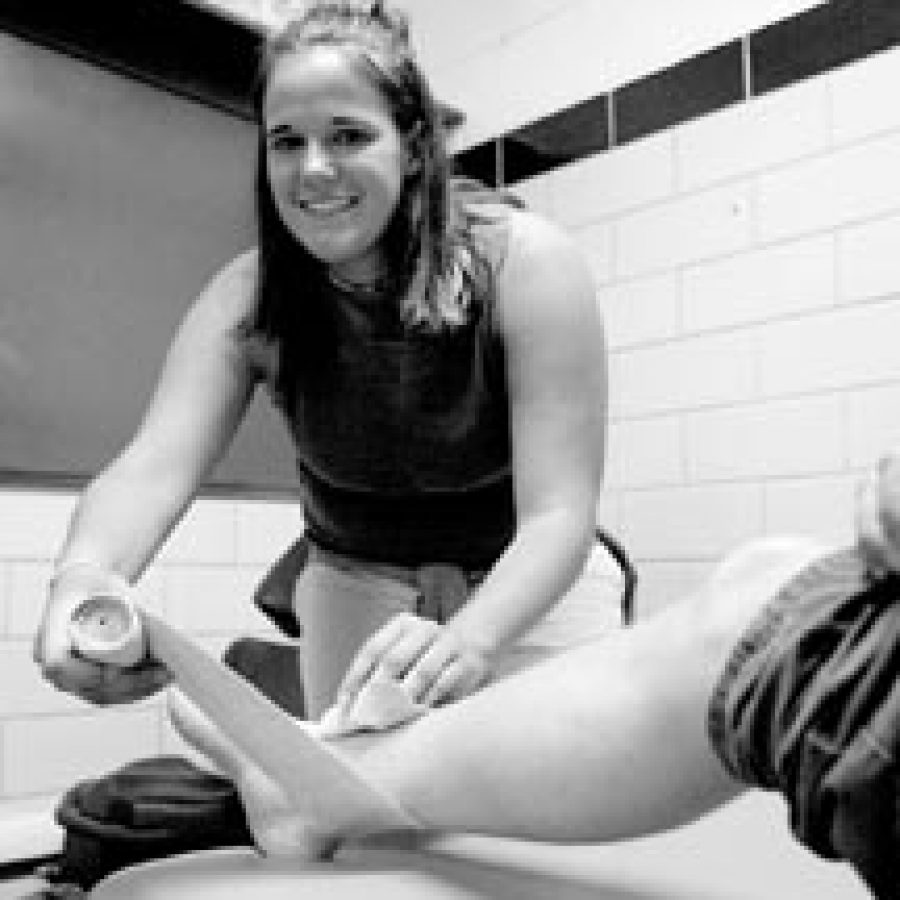 Bill Milligan photoTara Weiss, who is pursuing a career in sports medicine, demonstrates the skills she learned attending career clinics at the Missouri Bone and Joint Center.
