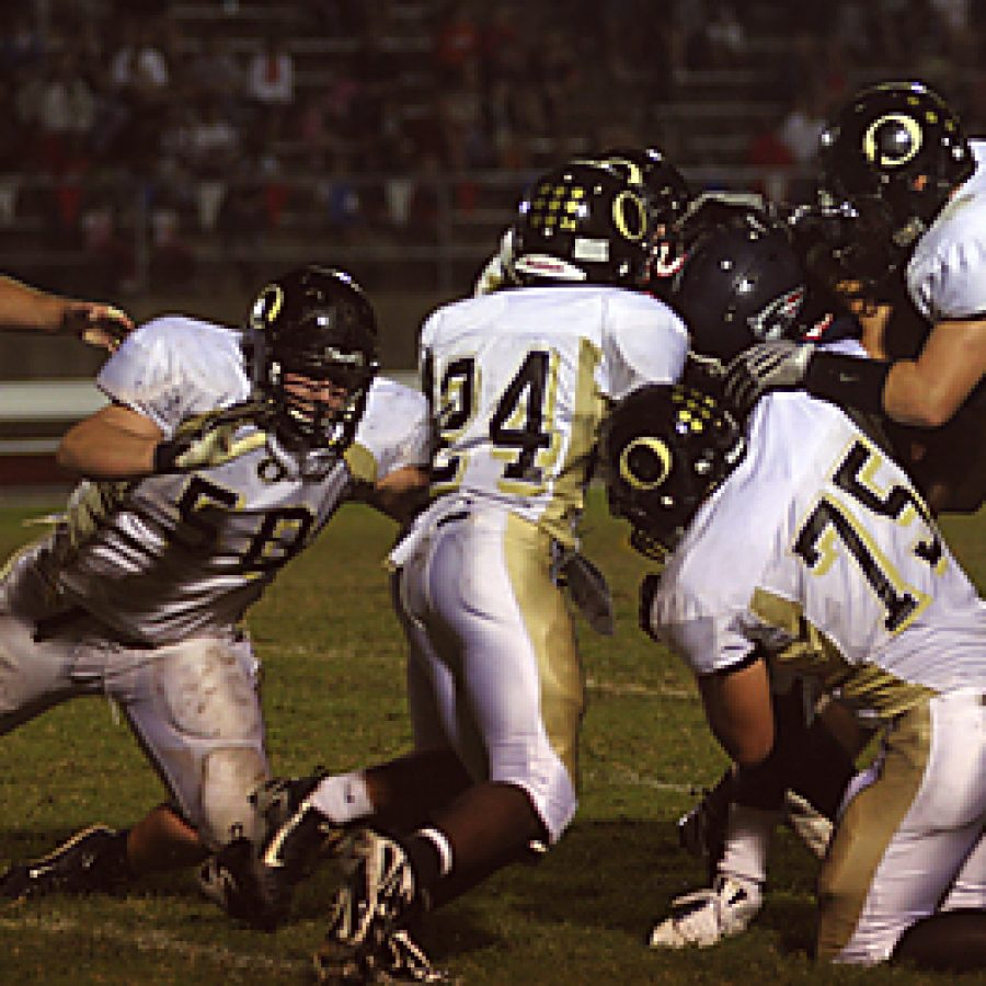Stephen Glover photoOakville Senior High School's Lavelle Boyd, Kody Kolb and Eric Simon take down Parkway South running back Lawrence Scott in the Tigers' 28-13 win over the Patriots Friday night. Stephen Glover photo