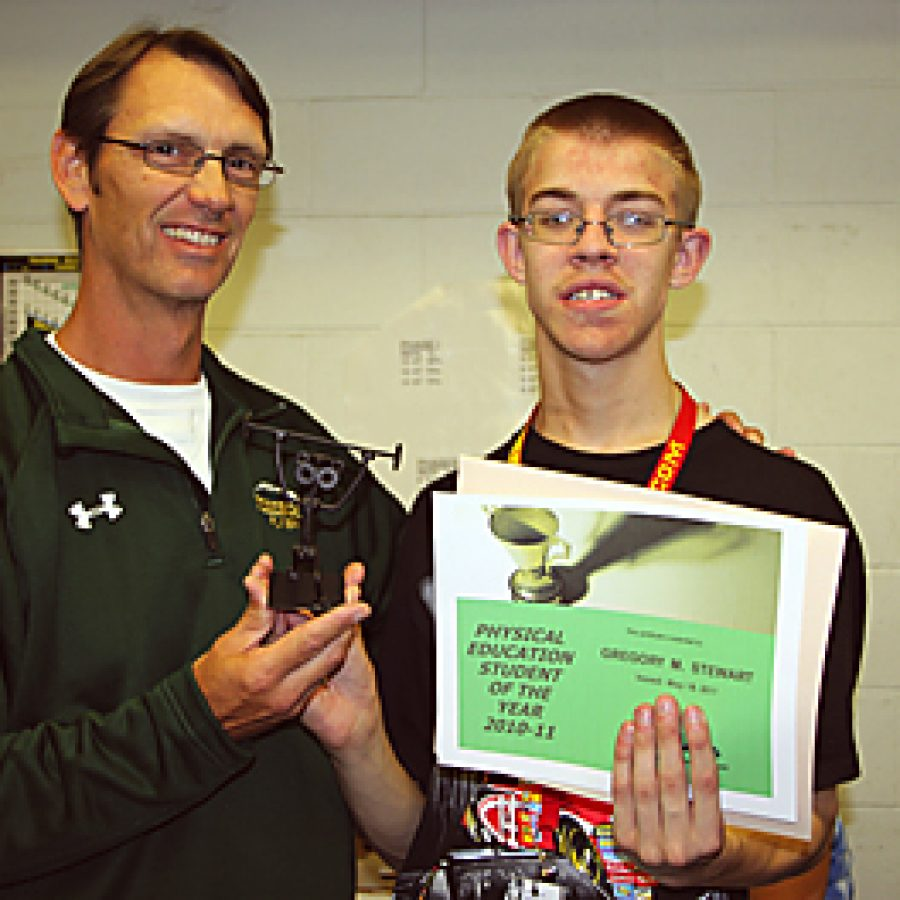 Lindbergh High School teacher Tom Girard, left, presents ninth-grader Gregory Stewart with the 2010-2011 Physical Education Student of the Year Award.
