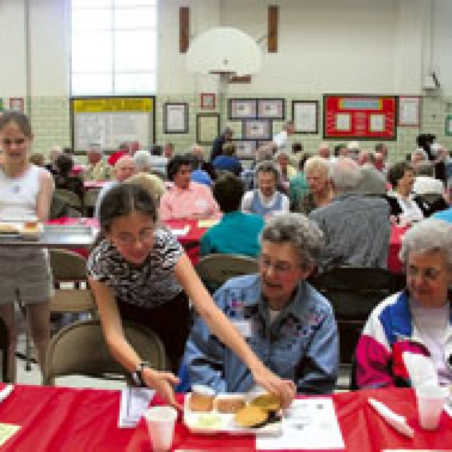 Bierbaum Accelerated School students serve lunch to their 60-Plus Club guests during the club's annual barbecue.