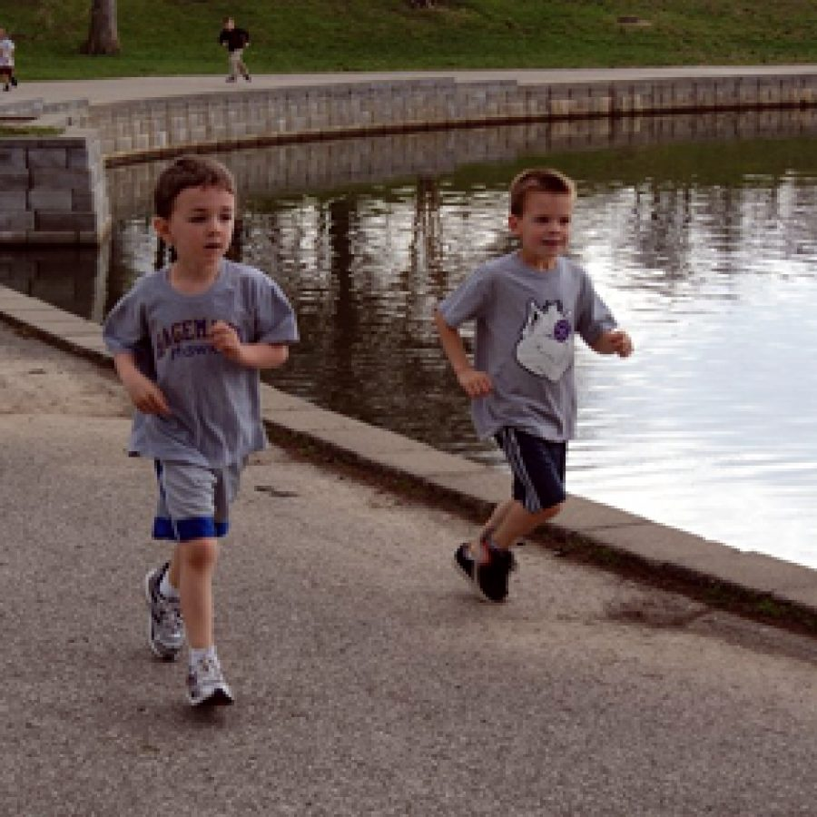 Hagemann Elementary kindergarteners Rich LaFlamme, left, and Marshall Ems participate in the school's Pond-A-Thon held on April 8 at Suson Park. Students raised nearly $3,000 in pledges for fun fitness the event, which benefited the Hagemann Parent Organization.