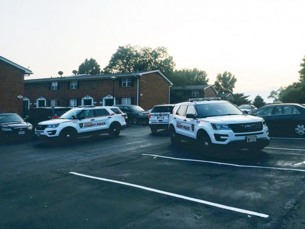 Police SUVs respond to the scene of a prank call saying a child had been shot at Covington Place apartment complex Sept. 11.