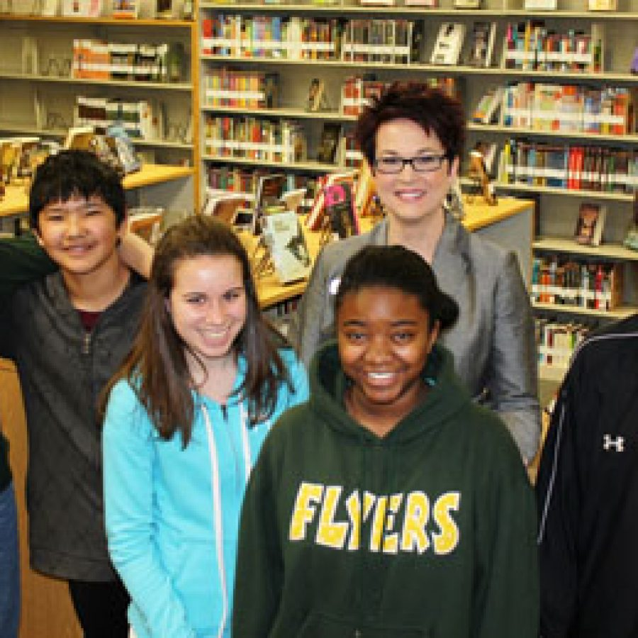 Truman Middle School Principal Jennifer Tiller has been named the 2012 Missouri Middle School Principal of the Year by the Missouri Association of Secondary School Principals. She is joined by eighth-grade students, from left, Kennedy Sabin, Murodbek Choriev, Madeline Boccardi, Briara Williams and Collin Breeding.
