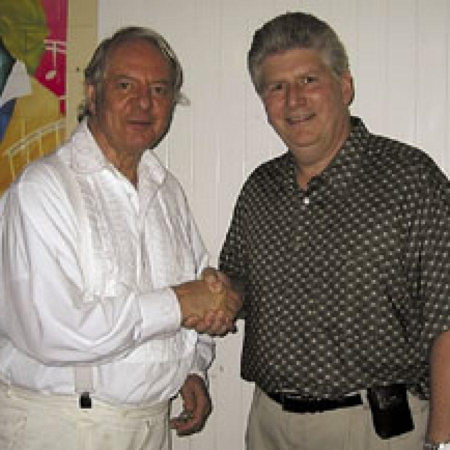 German composer Karlheinz Stockhausen, left, shakes hands with Lemay guitarist and composer Jim Stonebraker. Stonebraker personally was invited by Stockhausen to attend the 'Stockhausen Courses Kürten 2003' IN Kürten, Ger-many.
