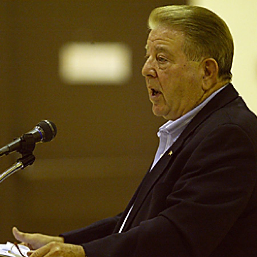 Mayor Roy Robinson addresses residents at last week's town-hall meeting. Bill Milligan photo