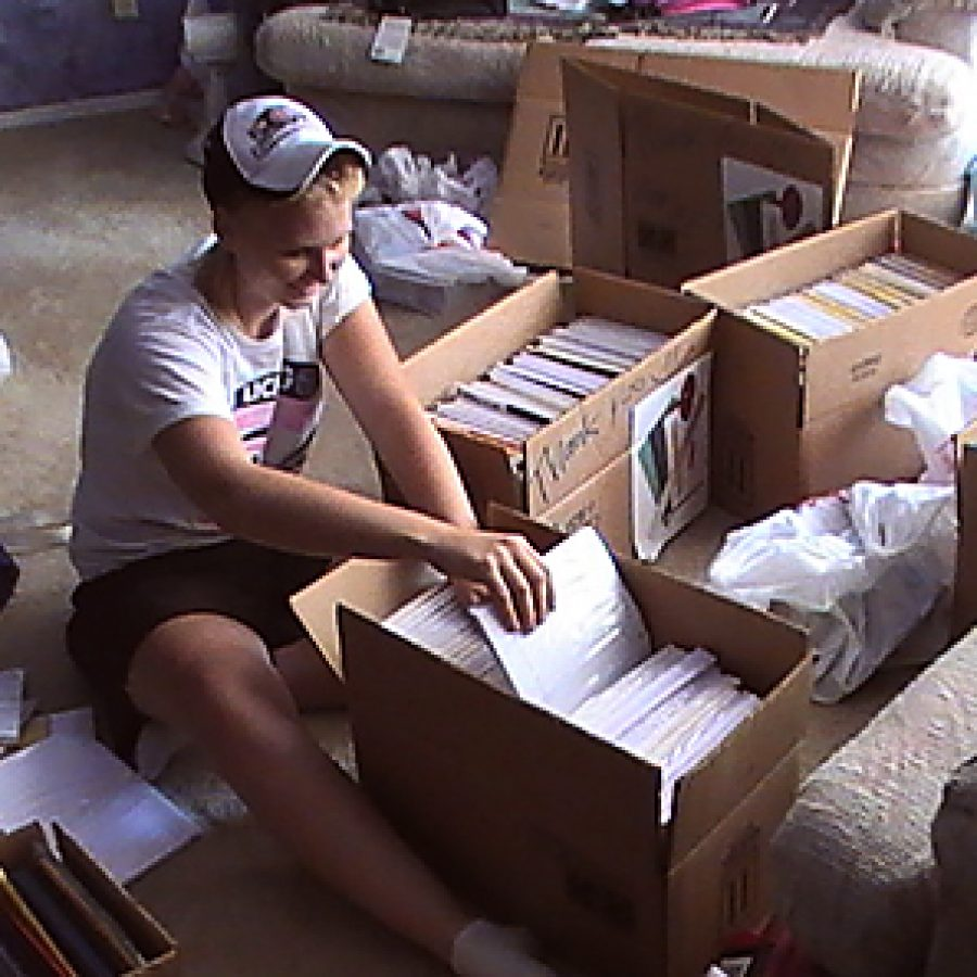 Lindbergh High School senior Abby Kaminski sorts the school supplies she collected last summer for Dunbar Elementary School. She sent letters to businesses and neighbors seeking donations of school supplies. Abby also ran a volleyball clinic for children at her church. Instead of charging for the clinic, she asked for donations of school supplies.