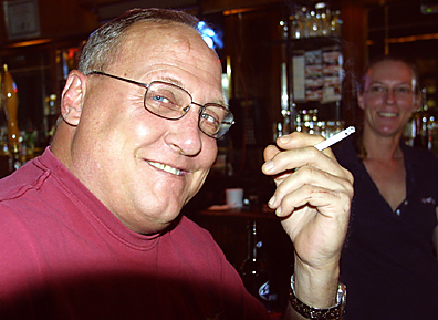 File photo: Concord resident Dan Logger opposed a 2009 smoking ban in public places because he believed it would affect businesses operated by many of his friends. 'I'm against it,' he said at the time. Also pictured is Schottzie's Bar and Grill bartender Lana Sugg. Photo by Bill Milligan.